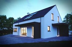 Night time view of passive dormer house with internal lights on.
