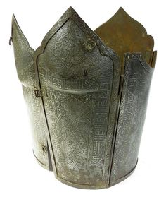 Persian Qajar era char-aina cuirass, very rarely encountered. Wrought of five plates, each cusped at the upper extremity, with hinged edges, the front plates with buckles. Elaborately etched overall with Persian heroes amongst foliage, and broad borders containing Kufic inscriptions and highlighted with silver inlay. First half of the 19th century. Overall height 42 cm. AuctionsImperial.com Plate Mail, Muslim Culture, Three Rings, Ottoman Empire, Central Asia, Military Art, Islamic Art, Persian, Leather Backpack