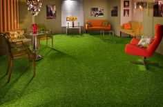Astroturf for the living room {bringing the outside in}. I like the vibrant armchairs too.