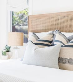 Dream bedroom idea withcane headboard and a soft cali design vibe. How to arrange pillows on a bed. How to make a guest bedroom feel welcoming. Bedroom Decor ideas on a budget Home Decor Accessories, Interior, Home Decor Bedroom, Home Bedroom, Cheap Home Decor, Home Decor, House Interior, Bed, Coastal Bedrooms