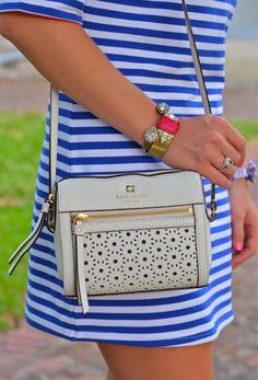 Kate Spade. I'd like a small purse like this if I need to carry one. Only have my wallet to carry anyway