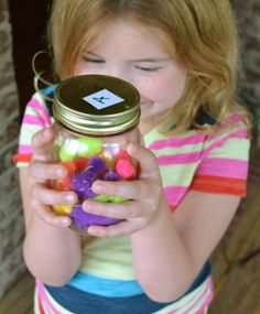 "LOVE THIS ---> ""This is The Warm Fuzzy Jar,"" - Whenever you do something helpful or kind, you place a pom-pom ball in your jar because kind and helpful acts make people feel good, like a warm fuzzy. 