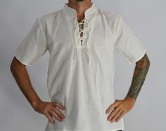 These shirts are light-weight cotton. They are super comfortable and a great addition to any renaissance festival costume or period… Renaissance Festival Costumes, Dj Spooky, Steampunk, High Collar, Larp, Tunic Tops, Shirts, Period, Mens Tops