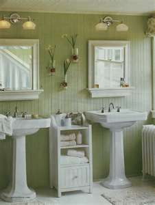 Twin Pedestal Sinks With A Bead Board Wall Painted In A Shade Of Sage Green  In One Of Bathrooms At Sage Farm.
