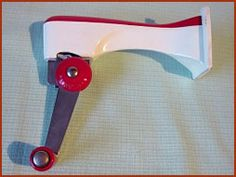 Wall-mounted can opener. Very HiTech in the day. I remember we had  one in the kitchen when we moved house when I was 9 '~)