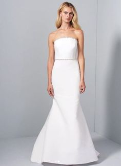 Style 42005 Emberly Allison Webb bridal gown - Snow blended faille fit to flare gown with crescent neckline, crystal trim detail, detachable sleeves and watteau train. Arriving in stores early Ball Dresses, Bridal Dresses, Bridesmaid Dresses, Mermaid Dresses, Designer Wedding Dresses, Beautiful Gowns, Neckline, Crystal, Gown Wedding
