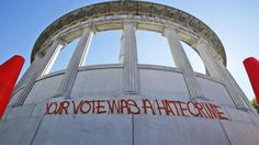 """""""YOUR VOTE WAS A HATE CRIME"""" graffitied on the monument to Jefferson Davis in Richmond, Virginia. (Steve Helber/AP)"""