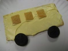 """Have students make an edible school bus during snack time on the first day of school. Give each student a graham cracker and a small cup of yellow icing. Have them """"paint"""" the cracker yellow. Add mini Oreo's for wheels, rice Chex mix for the windows, and a red M for the stop sign."""