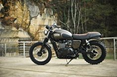 A Triumph, knobbys and a fantastic suede seat. What a stunning ride.