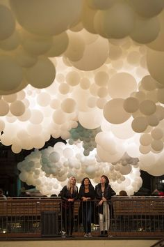 French artist & photographer Charles Pétillion unveiled a cumulus cloud composed of 100,000 white balloons illuminated from the inside at London's Covent Garden.