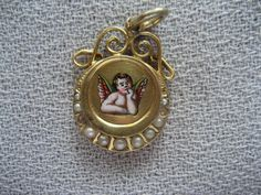Antique German Art Nouveau Silver Gilded enamel Cherub AngelCharm w Seed Pearls | eBay, sold for $75.00
