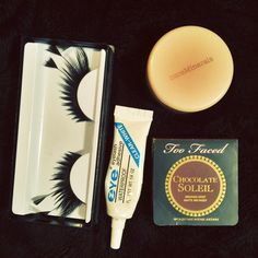 Too Faced / Bare Minerals / Eyelash Makeup Bundle 4 designer products! (1) NEW/Authentic never used 2.5 gram Too Faced Chocolate Soleil matte brown bronzer. (1) Pair of black long feather faux lashes. (1) Bare Minerals 0.85 gram Pearl Blossom blush. It's been used a decent about of times, but still has over 75% left. (1) Eyelash adhesive, compare to DUO brand. 7grams, clear, and about half left. This makeup bundle is for all 4 items. Too Faced Makeup