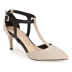 A two-tone T-strap pump shaped with a pointy toe is set on a tapered kitten heel for just-right height.
