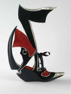 This 'sculptural shoe' attempts to capture the same sense of kinetic energy found in Wassily Kandinsky's 'Lithography for the fourth Bauhaus bag.' Fluid forms have been juxtaposed with angular structured lines. The softness of lamb nappa contrasts against the severity of metal and reflects the disparity of shapes within the image. (AP Photo/Bata Shoe Museum, Toronto) NO SALES   Copyrighted image MUST be credited: Copyright © 2009 Bata Shoe Museum, Toronto (Photo: Paterson Photographic) ORG…