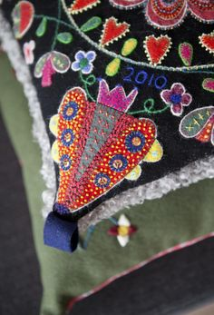 By Anna Wengdin - embroidery w/applique I love bright colors on a black background! Scandinavian Embroidery, Swedish Embroidery, Wool Embroidery, Wool Applique, Cross Stitch Embroidery, Embroidery Designs, Felted Wool Crafts, Felt Crafts, Textiles