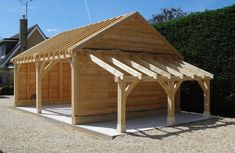 """""""Another garage completed - this one with attached lean-to log store, in Carport Sheds, Carport Plans, Carport Garage, Barns Sheds, Lean To Carport, Shed Design, Garage Design, Oak Framed Buildings, Firewood Shed"""