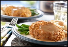 """BAKED PORK CHOPS & GRAVY You make the breading for these mouthwatering pork chops with stuffing mix...it couldn't be easier or more delicious. 1 Egg (beaten) 2 Tbsp. Water 6 Boneless Pork Chops (3/4"""" thick)      2 Tbsp. All-purpose Flour 1 1/2 Cups Pepperidge Farm® Herb Seasoned Stuffing (crushed)        1 Can (10 1/2 oz.) Campbell's®  Turkey Gravy http://www.themerchandiser.com/cooking-corner"""