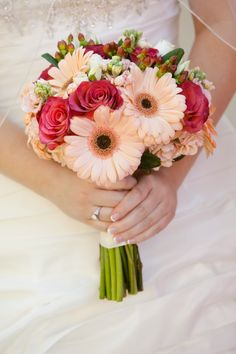 Wedding bridal bouquet: Peach gerbera daisies, terracotta roses, white stock, brown hypericum berries. Peach wedding