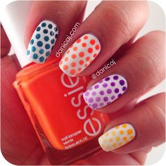 danicaj:Dotted gradient skittles!  4 polishes and mixed each colour with white to get it lighter and lighter.  Polishes Used: Sally Hansen - White On Color Club - Super Saturday Essie - Fear or Desire Illamasqua - Prosperity Sinful Colors - Pull Over