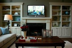Built in shelves idea for family room. Favorite Paint Colors: family room/living room (Quiver Tan by Sherwin Williams). Also loving the built-ins. Bookshelves Around Fireplace, Fireplace Built Ins, Fireplace Design, Bookcases, Decorate Bookshelves, Fireplace Mantle, Painted Bookshelves, Fireplace Seating, Bookcase Wall