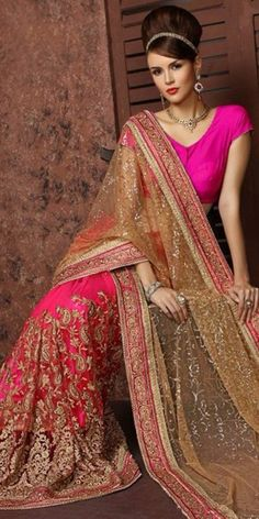 Alluring Pink Net Saree With Blouse.