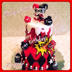 Two tiered Harley Quinn themed cake! By Finishing Touches!  #harleyquinn #cake #comic #villian  www.facebook.com/finishingtouchesbyliz