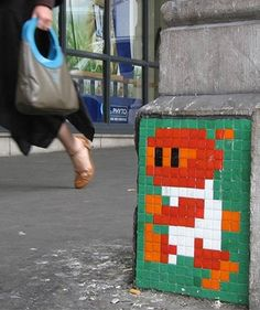 Street artist Invader - pixelated artwork.