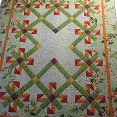 """This beautiful """"gift box quilt"""" a customer shows a perfect way to incorporate Hawaiian fabric into your quilt.  Fabric from: BarkclothHawaii.com"""
