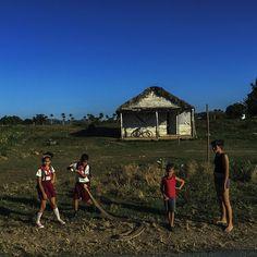 """""""schoolchildren play with a cuban boa snake in pinar del rio #cuba @magnumphotos"""". Michael Christopher Brown"""