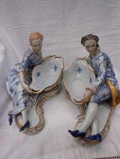 A pair of German porcelain oval bowls/sweetmeat dishes being held ...