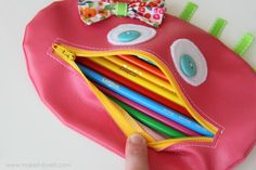 Zippered mouth pencil case for my younger gkids, the darlings! A terrific tutorial from a brilliant blogger, check her out! She's on /www.makeit-loveit.com/2012/08/zipper-mouth-pencil-case-girl-version.htmltoo!