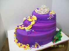 Tangled Birthday Cake - Chocolate Cake with purple and pink swirled MMF (tried to make it look tye-dyed). MMF w/ Tylose decorations. The crown is melted white chocolate and Pascal is Candy Clay. TFL