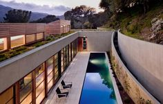 Living Roof on Slope House Merges Beautifully with California Hillside - The Kentfield Residence by Turnbull Griffin Haesloop Architects is located in northern California. Set into a steep hillside with two volumes overlooking the panoramic views of Mount Tamalpais as well as San Francisco Bay, the top volume also opens...