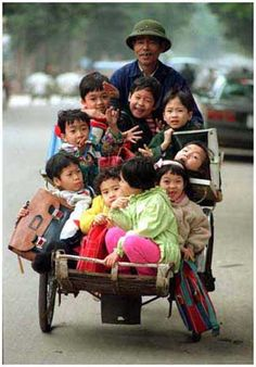 Vietnam~School Bus Service? They look like they are having fun,even if it means going to school.Maybe they're smiling because they are hitching a ride home ;-) <3