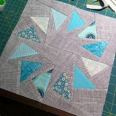 Stormy Skies Circle of Geese quilt block.  Paper-piecing Tutorial with lots of pictures