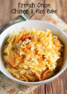 French Onion Chicken and Rice Bake recipe - chicken, french onion dip, cream of chicken soup, cheddar cheese, rice and french fried onions - use rotisserie chicken and it is ready for the oven in 5 minutes! On the table in 20 minutes! Super quick weeknight casserole! We made this twice in a week it was so good.