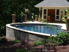 Pool Design Ideas - good for a sloping yard- would be awesome with a waterfall from stone wall! Description from pinterest.com. I searched for this on bing.com/images