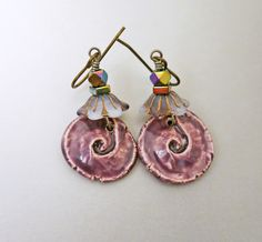 """These beautiful purple and lilac earrings were inspired by the handmade ceramic spiral charms. The spirals reminded me of a winding garden path. I topped the ceramic spirals with inverted Czech glass flower beads and topped them off with shiny faceted hemetite beads. These earrings are so pretty that they just put a smile on my face. Details for the """"Garden of Joy Earrings"""""""
