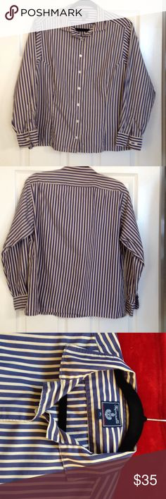 Faconnable women's striped blouse. Size XL. Faconnable women's tailored/tapered in front, striped blouse. Navy, yellow and cream stripes. Seven button front closure. Long-sleeved. Size XL, but fits more like a L due to tapering in front. Small tear at right and left bottom seams, that if repaired, will not be visible. Small wear marks at bottom of sleeve cuff. Very presentable and stylish. Faconnnable Tops Blouses