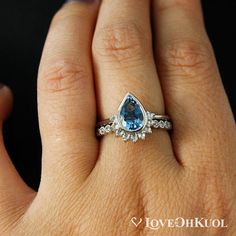 A modern twist on classic wedding aesthetics, this Bezel Set Teardrop Aquamarine Engagement Ring has a crown of beautiful rose-cut diamonds hugging the bottom of the teardrop, adding just the right amount of extra sparkle. Blue aquamarine is said to increase inner-peace, courage, and protection. You will fall in love with its vibrant blue hue. The engagement ring is paired with a simple and feminine half-eternity, bezel set, hand milgrained wedding band with 0.13 carats of sparkling white…