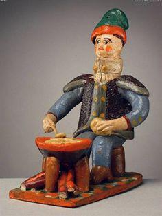 Pastor de barrete, a fazer as migas sentado (12,2 x 7,8 cm). Ana das Peles (séc. XX). Museu Nacional e Etnologia, Lisboa.
