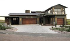 Earp Construction develops and sells properties in George on the Garden Route in South Africa. There are a range of design styles and sizes to suit your budget. Golf Estate, Open Living Area, Wooden Decks, Property For Sale, South Africa, Swimming Pools, Construction, Mansions, House Styles