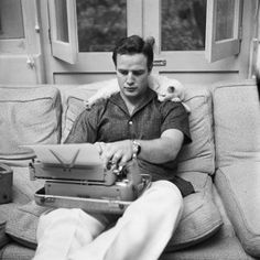 this picture embodies everything I could ever want... Brando, cat, typewriter.