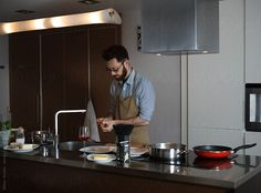 Man cooking at home by Milles Studio for Stocksy United
