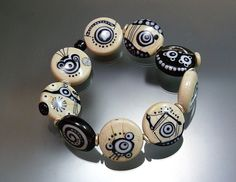 Elastic bracelet with 9 handmade glass beads in sandstone, black and white, see more of my work here https://www.etsy.com/shop/melaniemoertel