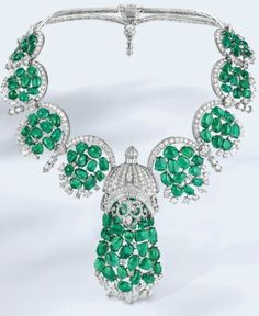 Van Cleef & Arpels Arcata necklace. Since this necklace is too ornate. It should be worn without any earrings, bracelet and ring and with the simplest evening gown, sans print and beading.