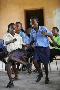 In Zimbabwe, children dance at a school in Harare, the capital. UNICEF assists the school and its AIDS club, an extracurricular programme that promotes HIV/AIDS awareness and prevention and supports children affected by HIV/AIDS.  --  © UNICEF/Giacomo Pirozzi  --  http://www.unicef.org/aids
