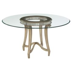Add a chic focal point to your dining room or breakfast nook with this lovely table, showcasing a round glass top and an antiqued silver leaf-finished base.