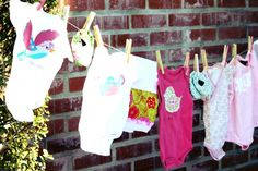 For the next baby shower you host, cover the clothespins in scrap paper. So darling!