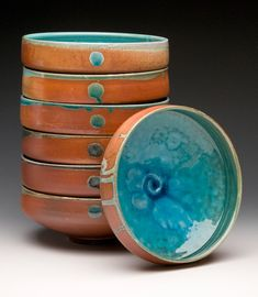 Laura Ross - Nested Bowls...as if I need anymore bowls...but just LOOK at the color of that glaze!!